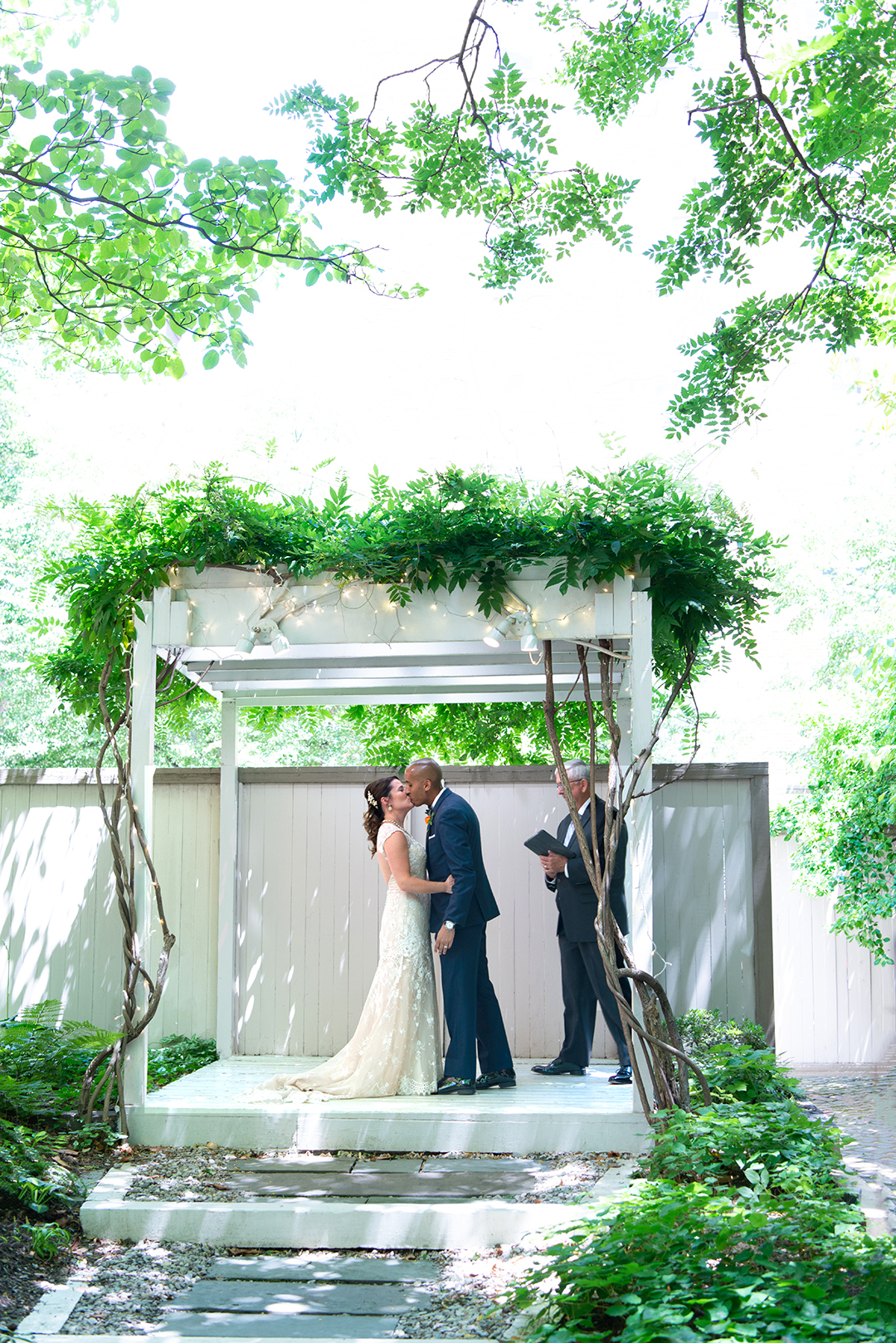 Micro-elopement wedding ceremony in the garden at Chase Court in Baltimore, Maryland