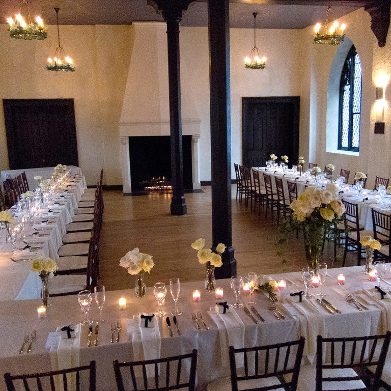 great hall with long wedding tables